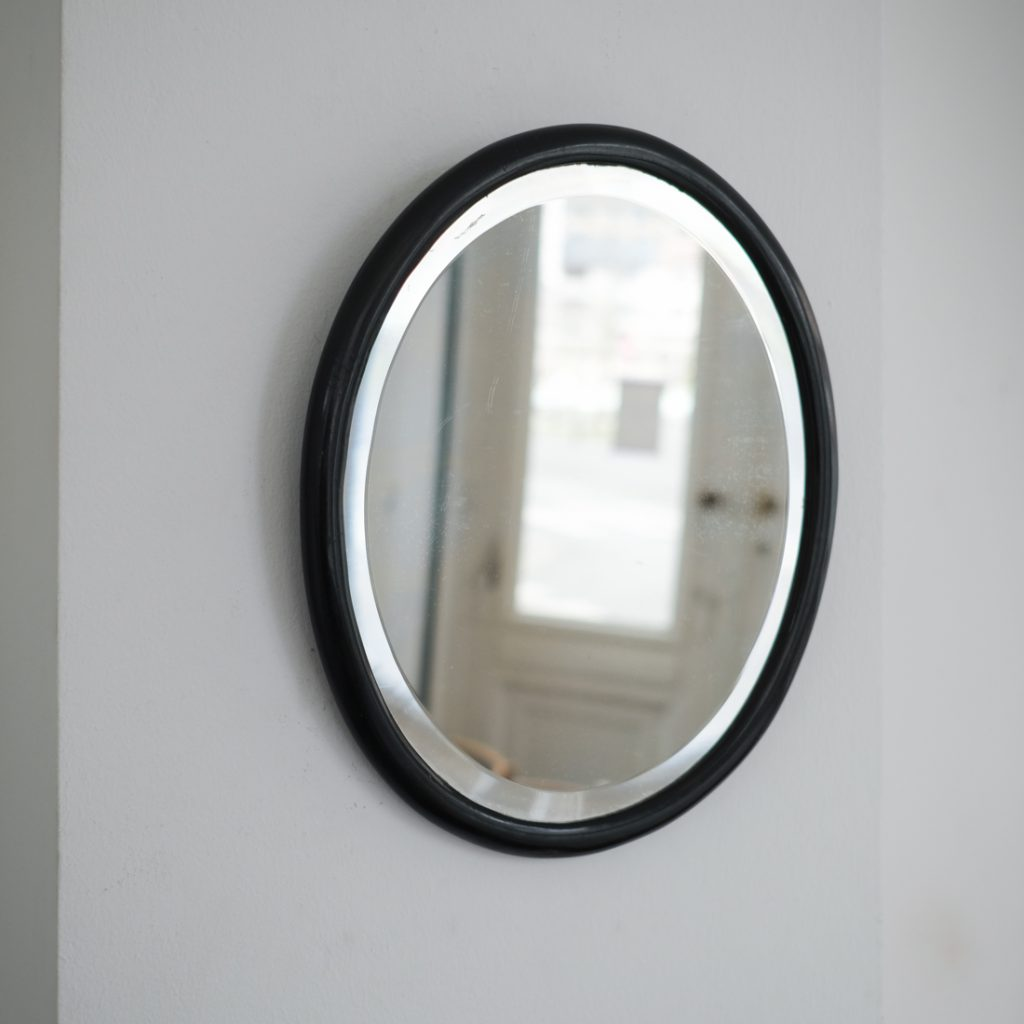 Petit miroir ovale noir